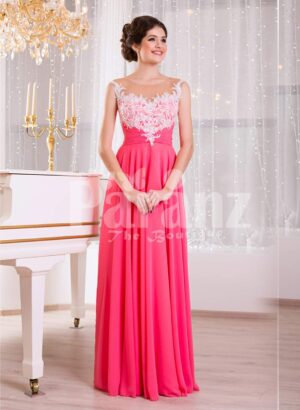 Women's pink evening gown with white floral appliquéd bodice and sleek tulle skirt