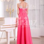 Women's pink evening gown with white floral appliquéd bodice and sleek tulle skirt back side view
