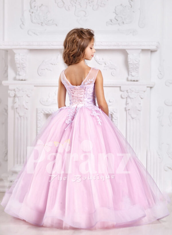 A plush and feminine formal pink dress for little girls back side view