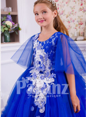 A superbly designed long formal dress for little girls in striking blue side view
