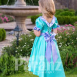 A touch of royalty for your little princess with this exotic blue formal dress side view